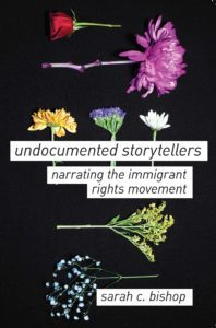 """Cover of Sarah C. Bishop's Book. Black background with dried flowers and text that reads """"undocumented storytellers. narrating the immigrant rights movement"""""""