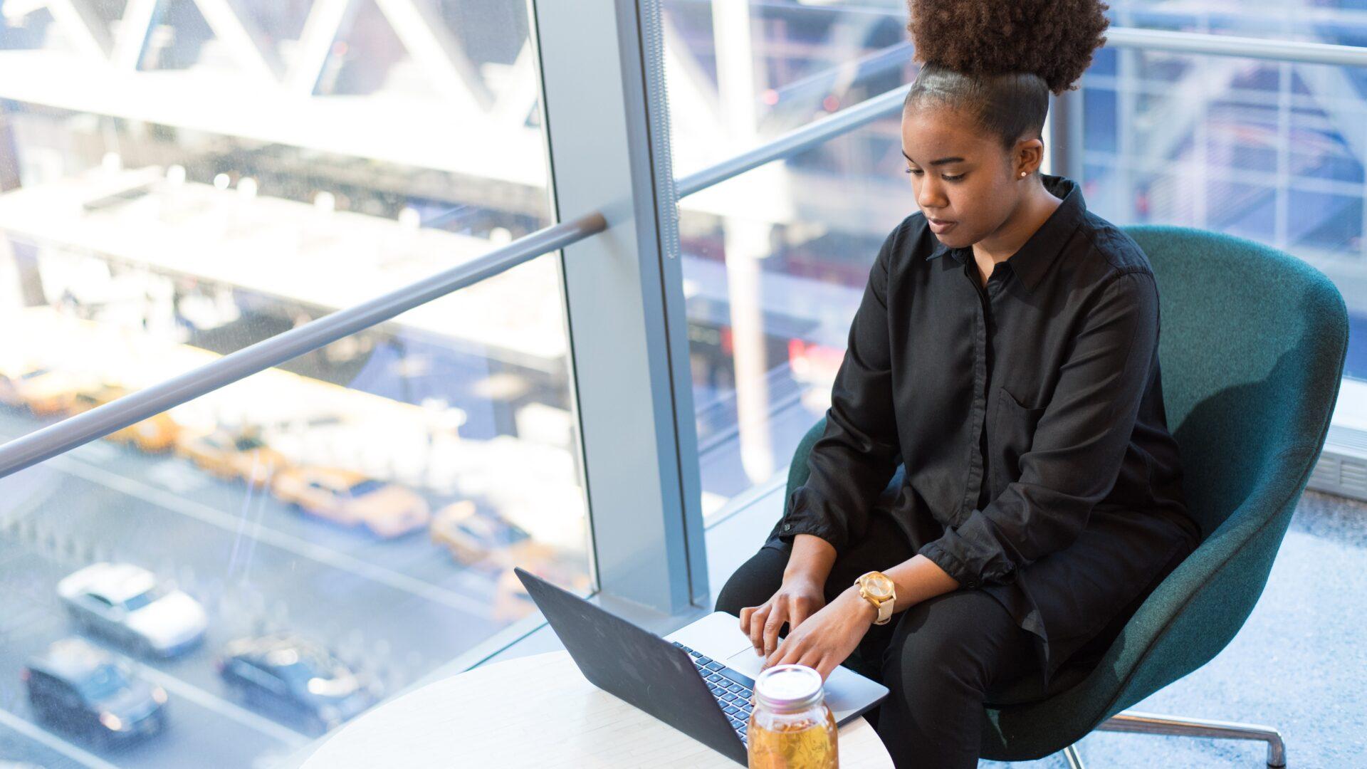 woman laptop window