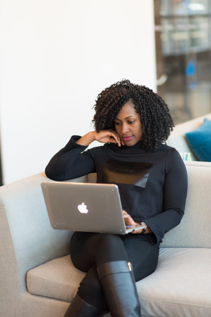 woman sitting down looking at laptop